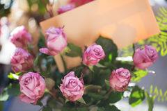 Bouquet of pink roses with letter on natural background. Soft focus in natural light stock image