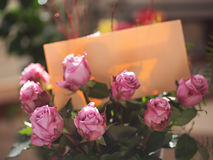 Bouquet of pink roses with letter on natural background. Soft focus in natural light stock photos