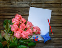 Bouquet of pink roses with a love letter Royalty Free Stock Photography