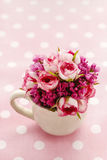 Bouquet of pink roses on pink dotted background Stock Image