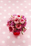 Bouquet of pink roses on pink dotted background Stock Photo