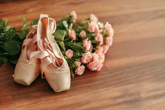 Bouquet of pink roses and pointe shoes Royalty Free Stock Images