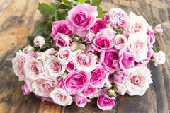 Bouquet of Pink Roses on a Rustic Wooden Table Stock Photos