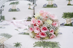 Bouquet of pink roses on sofa Stock Image