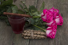Bouquet of pink roses and tea with cookies Royalty Free Stock Image