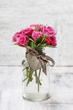 Bouquet of pink roses in transparent glass vase, Royalty Free Stock Photo