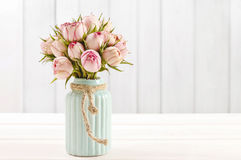Bouquet of pink roses in turquoise ceramic vase Royalty Free Stock Photography