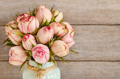Bouquet of pink roses in turquoise ceramic vase Stock Images