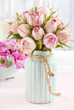 Bouquet of pink roses in turquoise ceramic vase Stock Photos