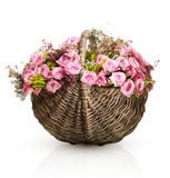 Bouquet of pink roses in wicker basket Royalty Free Stock Images