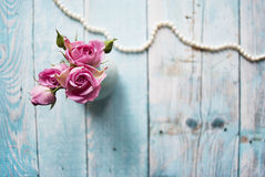 Bouquet of pink roses on a wooden background with the place for your text. Royalty Free Stock Images