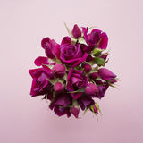 Bouquet of pink roses on a wooden background with the place for your text Royalty Free Stock Image