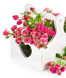 Bouquet pink roses in wooden basket Stock Image