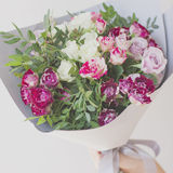 The bouquet of pink spray roses in the gray paper. On white background Royalty Free Stock Images