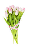 Bouquet of pink tulips decorated with ribbon isolated over white. Valentines Day concept Royalty Free Stock Images