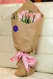 Bouquet of pink tulips. Flower bouquet of pink tulips on pastel background Royalty Free Stock Photo