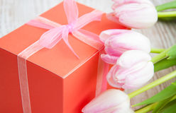 Bouquet of  tulips, gift box on a table Royalty Free Stock Images
