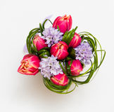 Bouquet of pink tulips and grass. Bouquet of pink tulips and green grass on white background Stock Photos