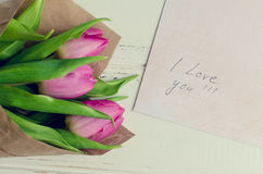 Bouquet of pink tulips with notes I LOVE YOU Stock Photos