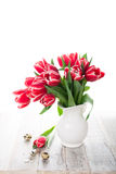 Bouquet of pink tulips in vase on the white background Royalty Free Stock Photography