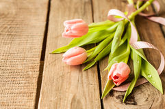 Bouquet of pink tulips on vintage wood table Royalty Free Stock Photo