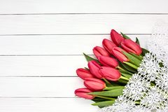 Bouquet of pink tulips on white wooden background. Top view Royalty Free Stock Photo