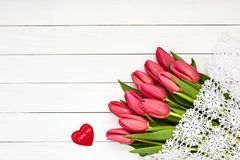Bouquet of pink tulips on white wooden background. Top view Royalty Free Stock Photos