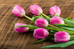 Bouquet of pink tulips on a wooden table Royalty Free Stock Photos