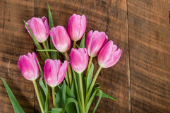 Bouquet of pink tulips on a wooden table Stock Photo