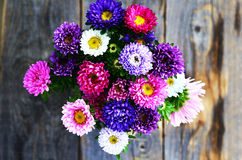 Bouquet of pink, violet and white aster over wooden background Stock Image