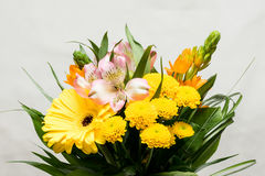 Bouquet of pink, white, orange and yellow flowers. Many different blossoms. Big gerbera bloom. Blooming chrysanthemum, white fabri Royalty Free Stock Image
