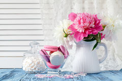 Bouquet of pink and white peony flowers on wall panelling backgr. Ound Stock Images