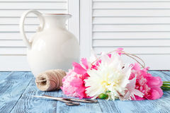 Bouquet of pink and white peony flowers on wall panelling backgr. Ound Stock Image