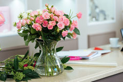 Bouquet of pink and white roses in vase Stock Images