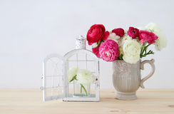 Bouquet of pink and white rosses in the vintage white vase Stock Photo
