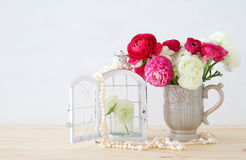Bouquet of pink and white rosses in the vintage white vase royalty free stock photo