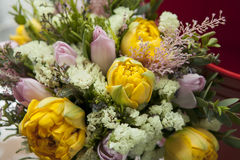 The Bouquet of pink and yellow tulips with dried flowers for the Royalty Free Stock Photos
