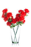 Bouquet of plastic red roses in glass jar Stock Photography