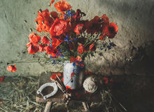 A bouquet of poppies. And cornflowers in a rustic style Royalty Free Stock Images