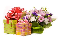 Bouquet and present boxes Royalty Free Stock Photos