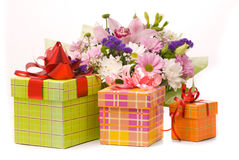 Bouquet and present boxes Stock Photography