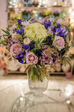 Bouquet with purple , blue and white different flowers. In vase Royalty Free Stock Photos