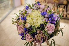 Bouquet with purple , blue and white different flowers. In vase Stock Image