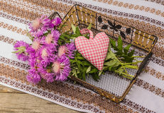 Bouquet of purple cornflowers and heart Stock Photo