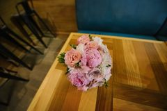 Bouquet of purple flowers lies close up. A bouquet of purple flowers lies on a chair close-up beautiful white pink lying wedding design decor decoration bridal royalty free stock image