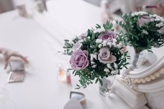 Bouquet of purple flowers lies close up. A bouquet of purple flowers lies on a chair close-up beautiful white pink lying wedding design decor decoration bridal stock photography