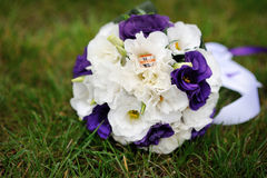 Bouquet of purple flowers lying on the grass Stock Photo