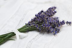 Bouquet of purple lavender tied with ribbon on lace cloth Royalty Free Stock Photo