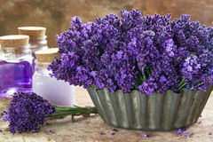 Bouquet of purple lavenders and spa products Stock Photos