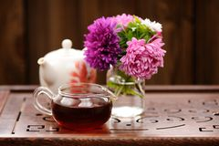 Bouquet of purple and pink asters and teaware for chinese tea ce Royalty Free Stock Photo